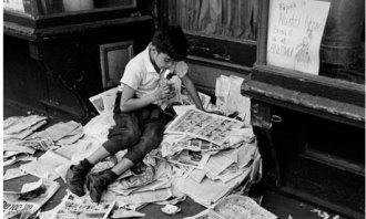 Boy-reading-newspaper-New-001